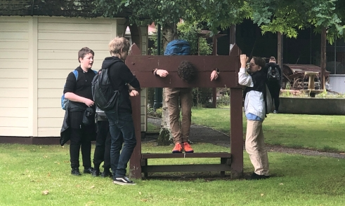 Actors working out how to use the stocks in their performance.